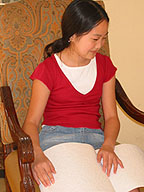 A young girl reads a Braille book.